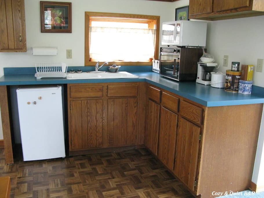 kitchen area with mini fridge, convection oven, microwave, toaster, coffee pot and hot water pot, coffee and tea included