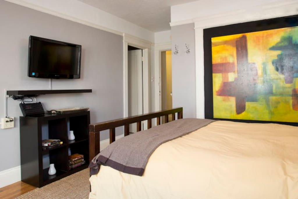 Lounge away the morning in the queen bed, conveniently in view of the flat-screen TV.