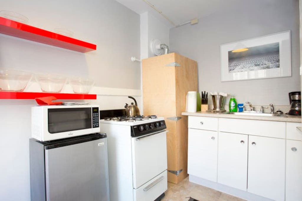 The kitchen has everything you need to whip up a good meal, including a stove/oven, mini fridge, and toaster.