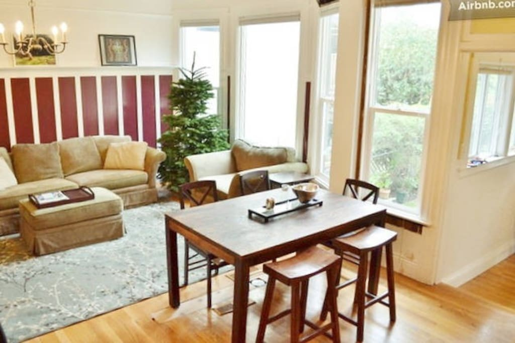 Living room (from kitchen). The space is open and bright, with lots of light.  (Christmas tree is seasonal!)