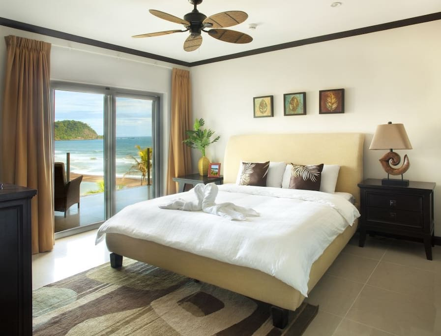 Master bedroom  with a king size bed and walk out balcony. Wonderful ocean and beach view.