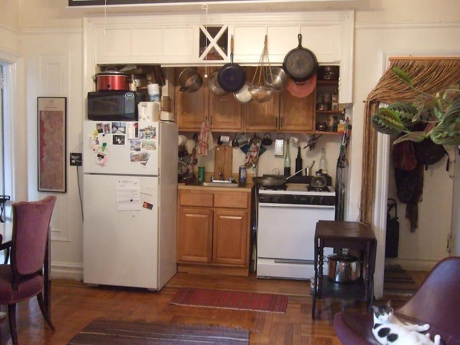 Fully stocked kitchen alcove.