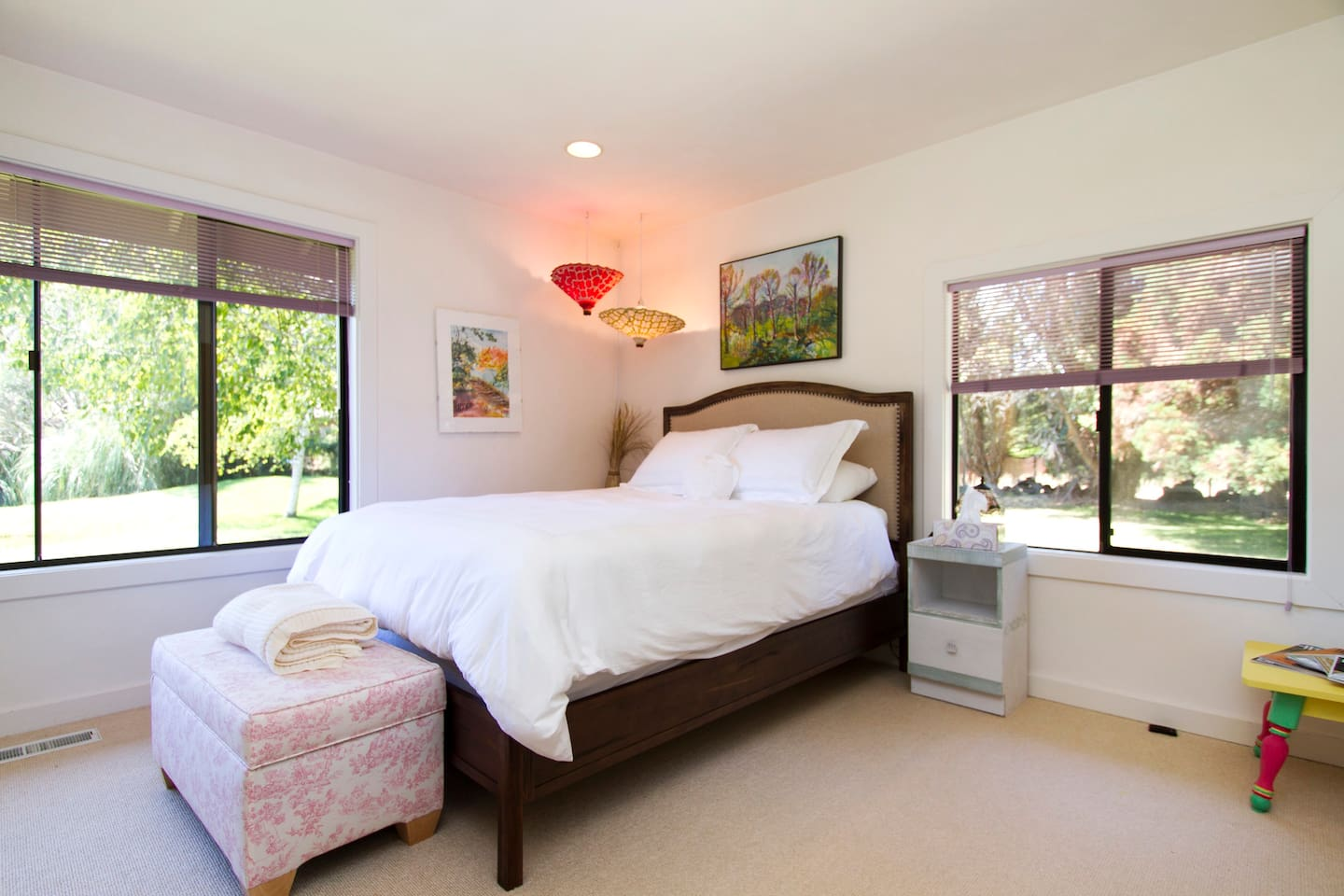 Large bright master suite with views of backyard pond and hills.