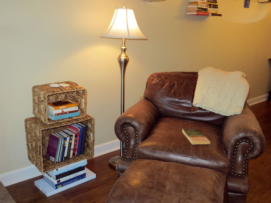 Relax with a book on the comfy leather chair.