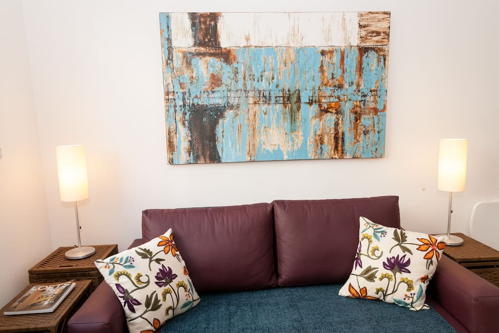 Sofa with original artwork by local artist.