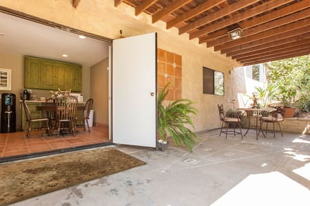 Located in a quiet neighborhood .06 mi. from The Grand Traditions Wedding Venue, This is The location close to downtown Fallbrook with its quaint shops and restraunts.  Private entrance, large bedroom, lounge area, dining room. patio, spa, fireplace.
