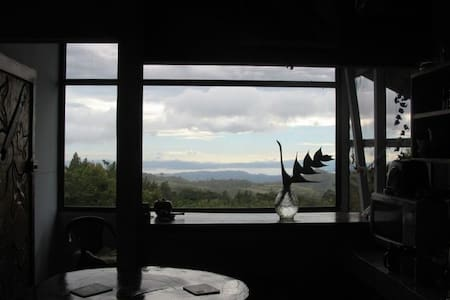 Secluded house in a guava forest located 1.5 miles from Santa Elena. Appropriate for families or couples. It has large windows with spectacular views to Gulf and Peninsula of Nicoya, sunsets, birds, rainbows and mountains.
