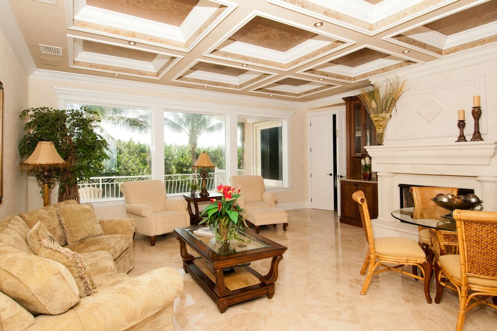 Walk into a lovely sun room sitting area, Where you can relax and take in the amazing views.