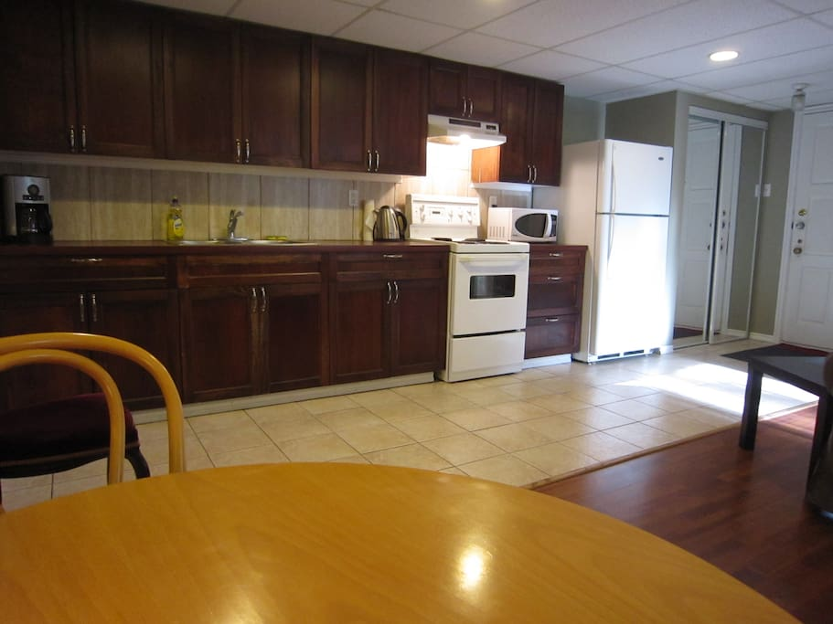 Kitchen with stove, fridge/freezer, coffee maker, microwave, all pots, pans, utensils etc needed for stay