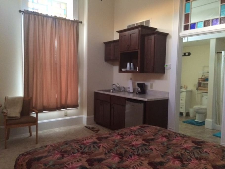 View of furnished kitchenette, and the bathroom.