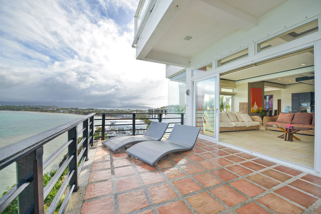 Private Large Terraces with lounge chairs and seating areas!!