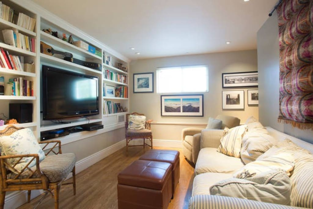 TV Room adjacent to downstairs bedroom & bath