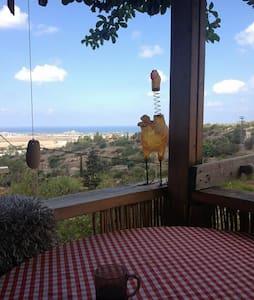 Pastoralic artist village sea view - House