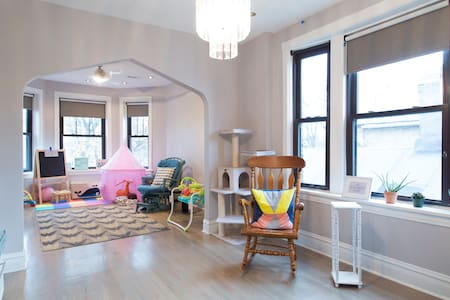 sunny, spacious, & colorful room!