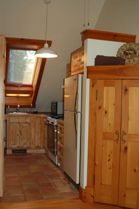 Galley kitchen, lots of natural light.