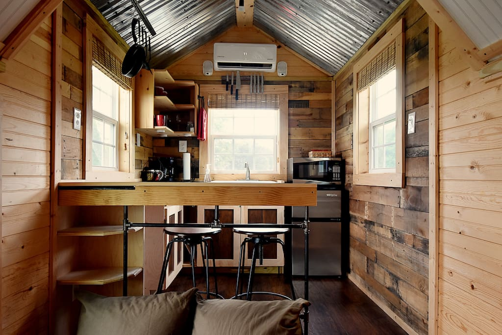 Tiny house on the christmas tree farm in manvel for Kitchen 713 reservations