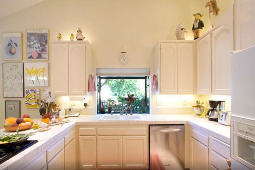 The homey, welcoming  kitchen features a gas cooktop, refrigerator with ice maker and filtered water, microwave oven, dishwasher, and a full pantry of seasonings.