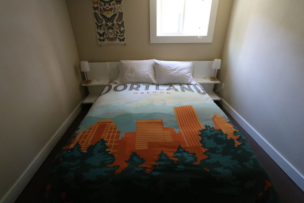 Brand new memory foam queen sized bed from CB2 with custom printed vintage travel postcard bedspread.