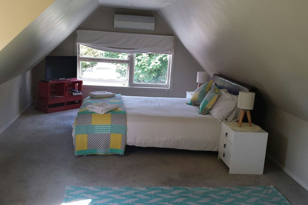 Comfortable and stylish sleeping area. Brand new queen mattress. Heat pump/air conditioning unit. .