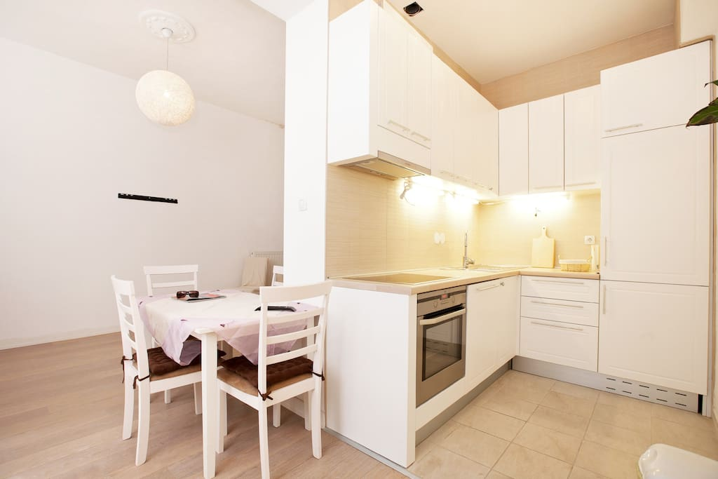Kitchen, fully equipped with Electrolux new appliances including large fridge, oven, dishwasher, kettle, coffee maker etc.