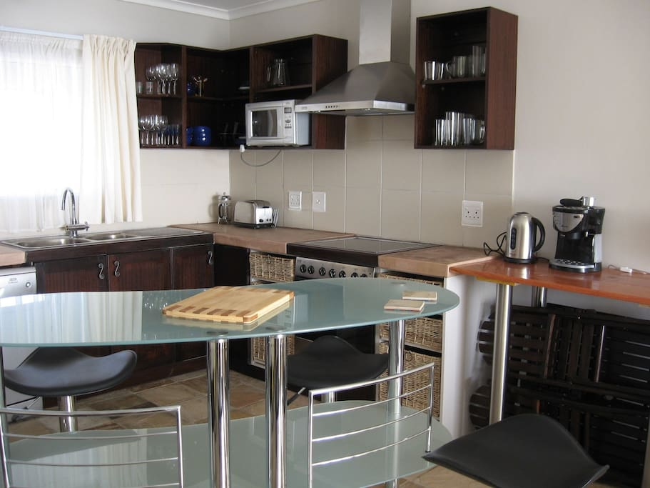 Kitchen and breakfast bar, looking from lounge (please note, the curtain and stools were changed due to wear.