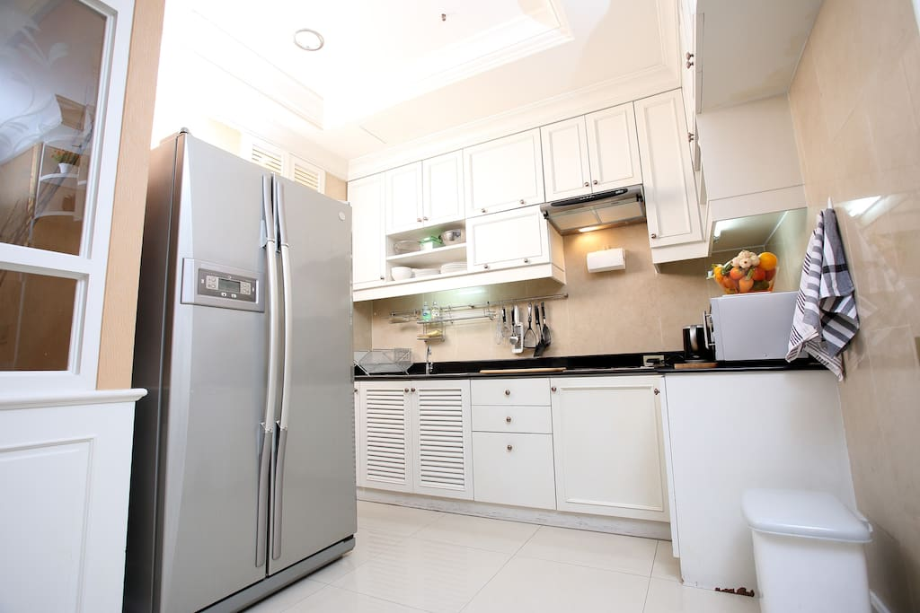 Fully fitted kitchen with appliances.