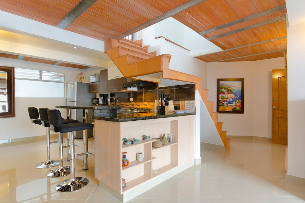 Kitchen and stairs to rooftop