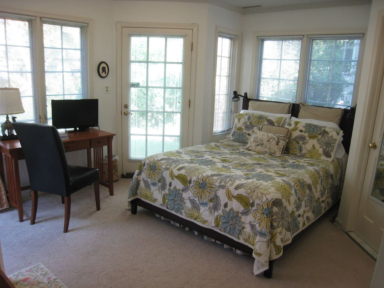 New Queen bed and a desk with comfortable seating where you can pour over maps as you plan your visit.