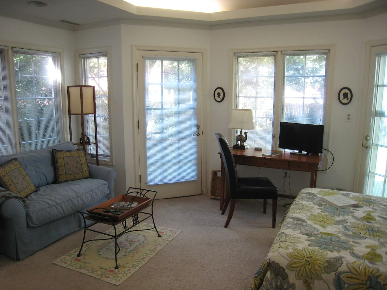 Our conservatory room features cathedral ceilings and wrap around windows