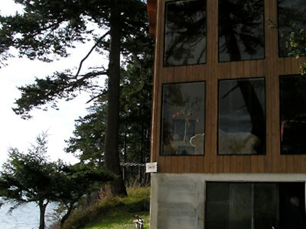 Lummi Island Home Front View - Double story windows on both sides provide amazing panoramic view.