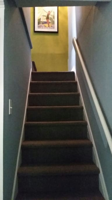 same stairway  with different view leading from downstairs to bathroom and kitchen upstairs make sure stairs are not a problem