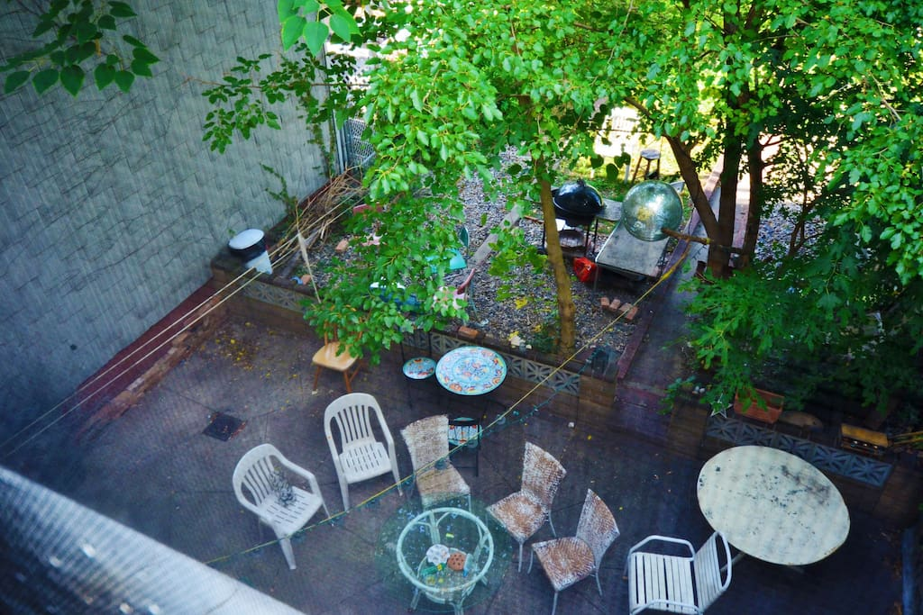 A bird's eye view of the lovely backyard! A lot of privacy and plenty of room to relax.