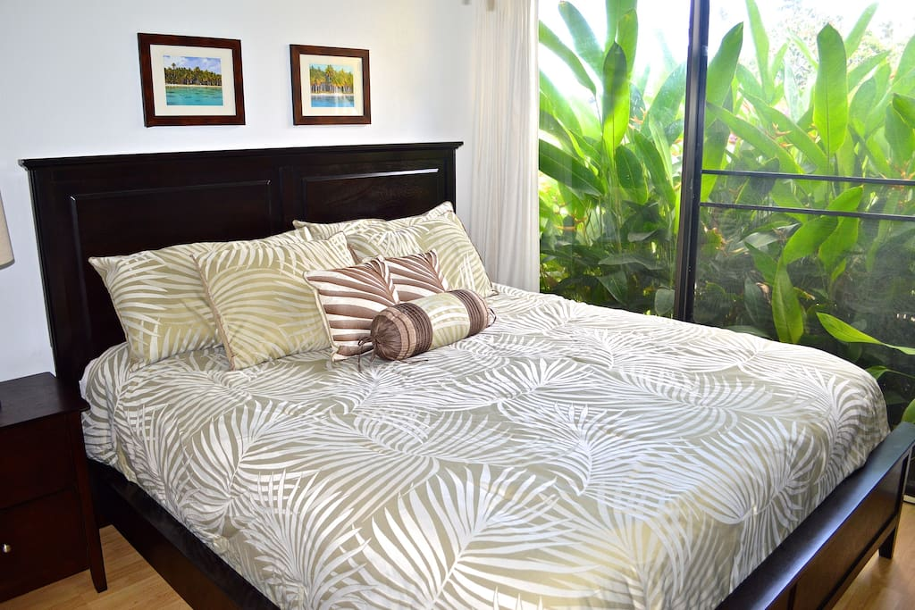 The bedroom features a new bed & furnishings, AC & flat-screen tv with cable TV.