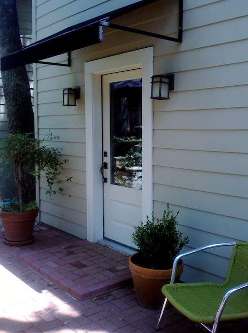 Private entry in quiet back yard