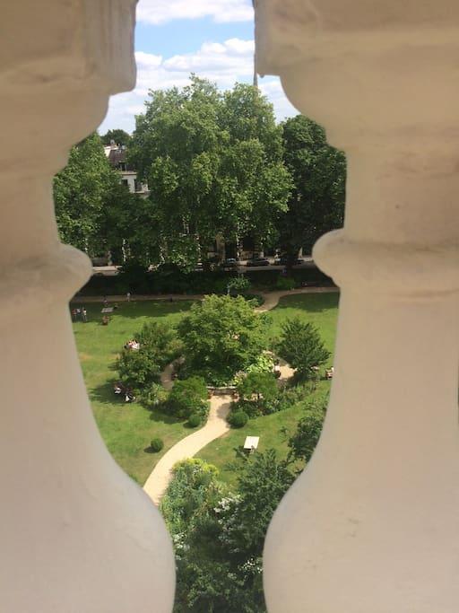 A view of the garden through the ballustrade on the terrace