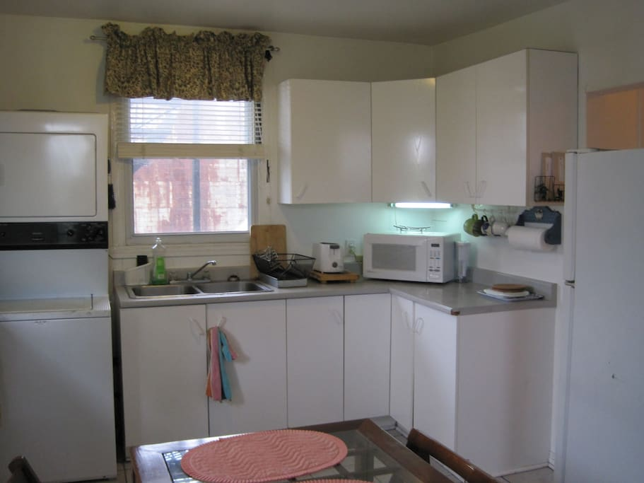 large kitchen with all the appliances, washer and dryer