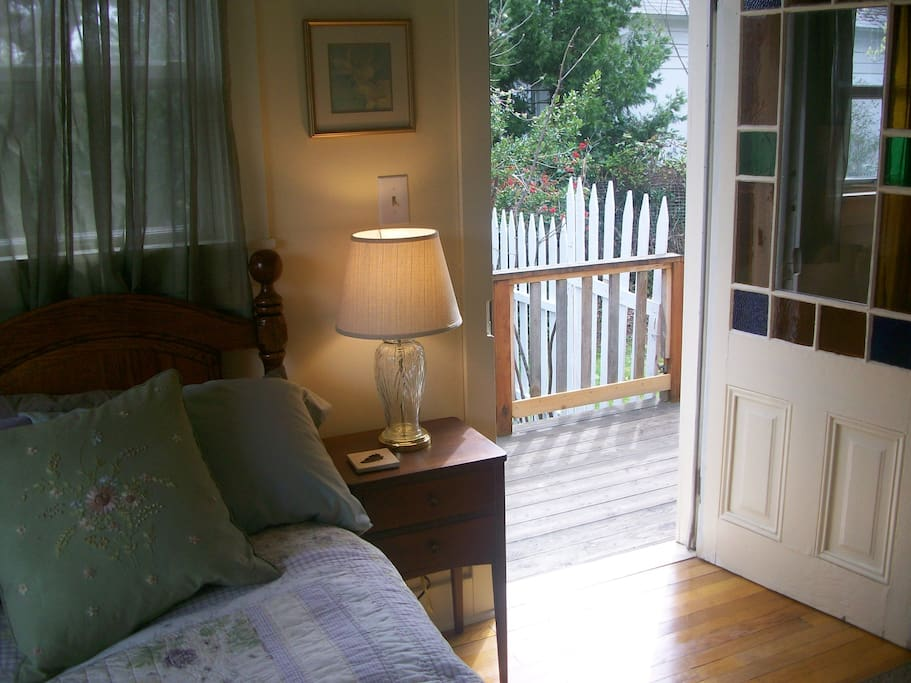 Lovely light filled room with porch