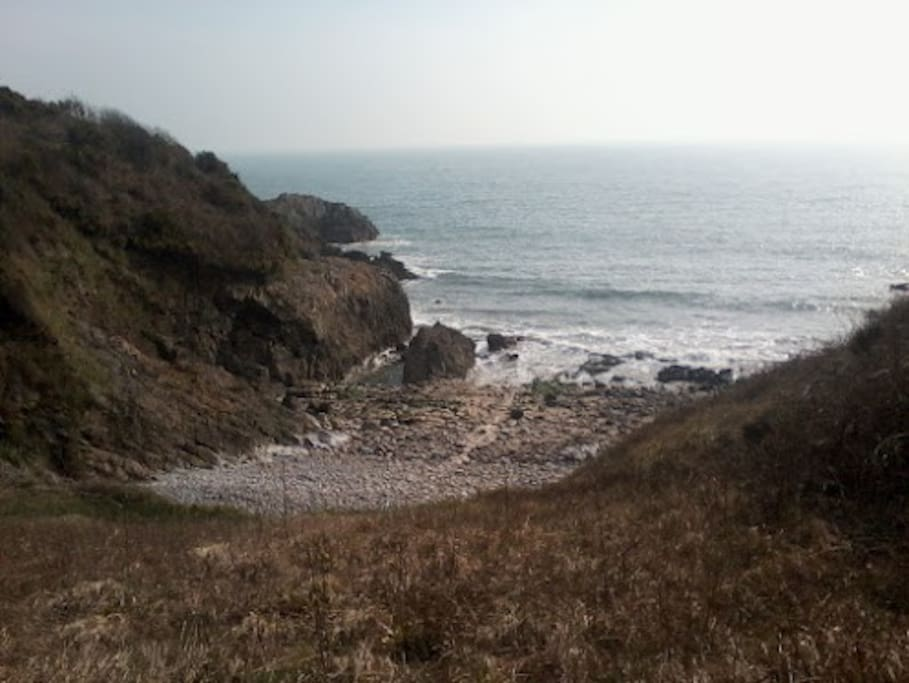 View from the coastal path. Can be reached by foot if you are very energetic or bus ride. Stop is about two mins walk from house.