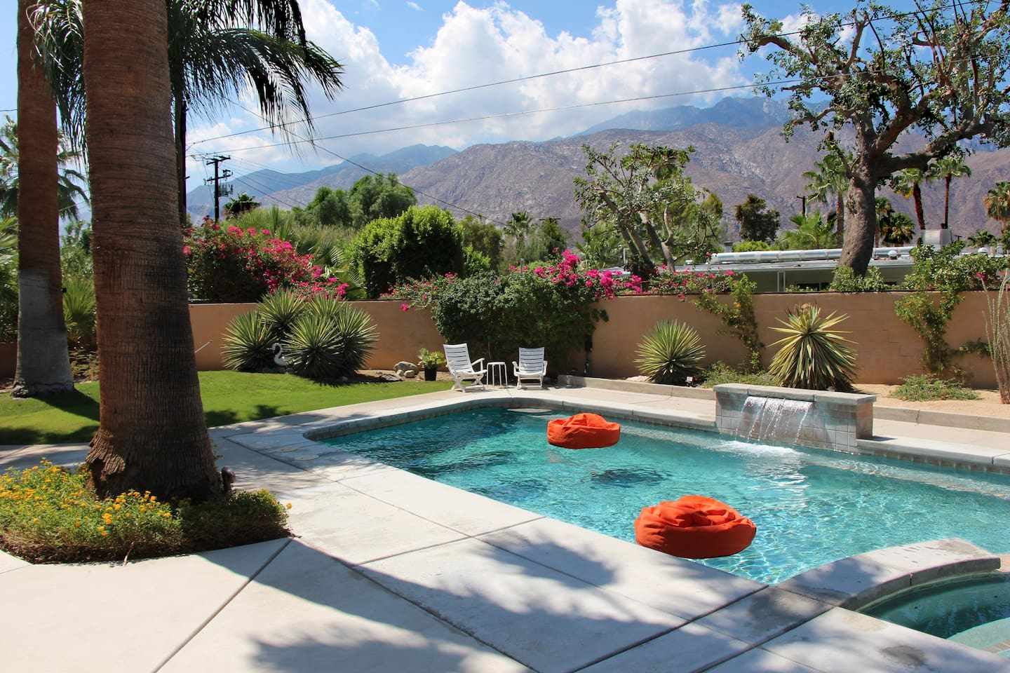 Enjoy the mountain views while floating on the pool beanbags, under the palms, drifting away to sounds of the waterfall.