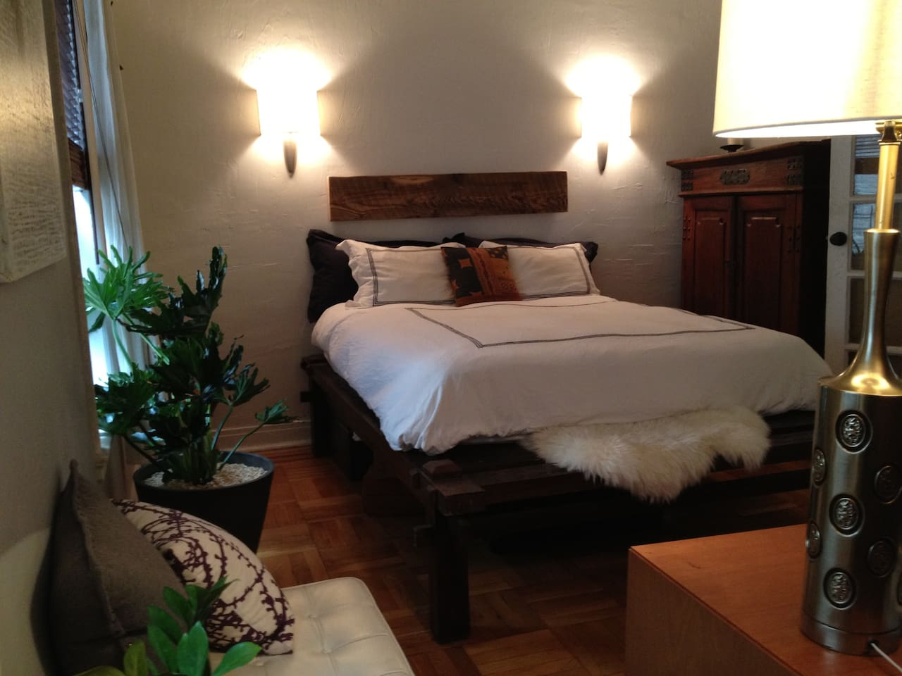Large Bedroom with Teak queen platform bed, Teak cabinet, Cherry wood chest of drawers & Wht Barcelona Ottaman