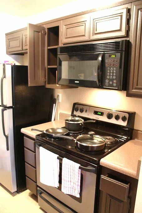 Full kitchen in the apartment.  It's ALL for just you!  Comes with cookware, silverware, cleaning supplies, soap, etc.