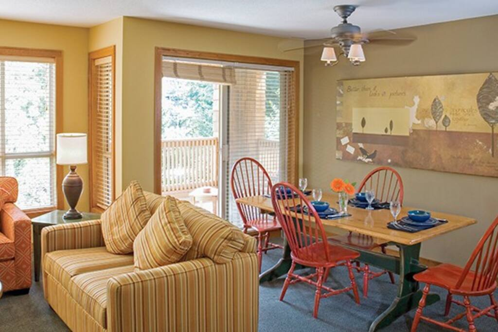 Full sized living and dining areas with seating for up to 8 guests
