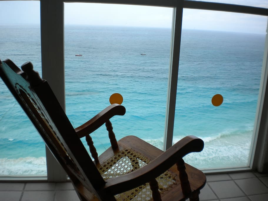 Sit in your rocking chair by your Wall of Windows!  You are floating on the water!