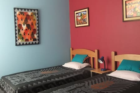This is a newly decorated twin room with shared modern family sized bathroom. The room is spacious and comes complete with large closet drawers, night stand and reading lamps. With prior notice we can change this into a double bedroom gratis.