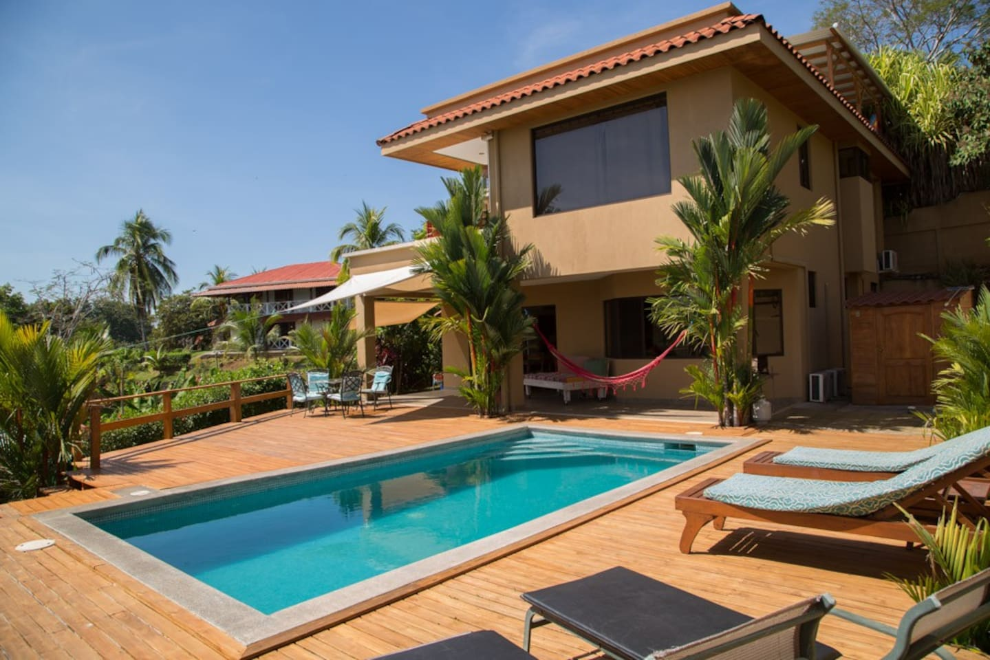 Pool, deck and house
