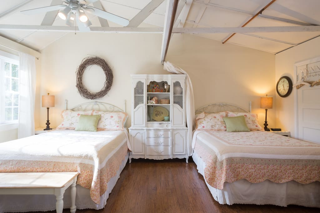 Super comfy Sealy Posturpedic queen beds with top quality linens.