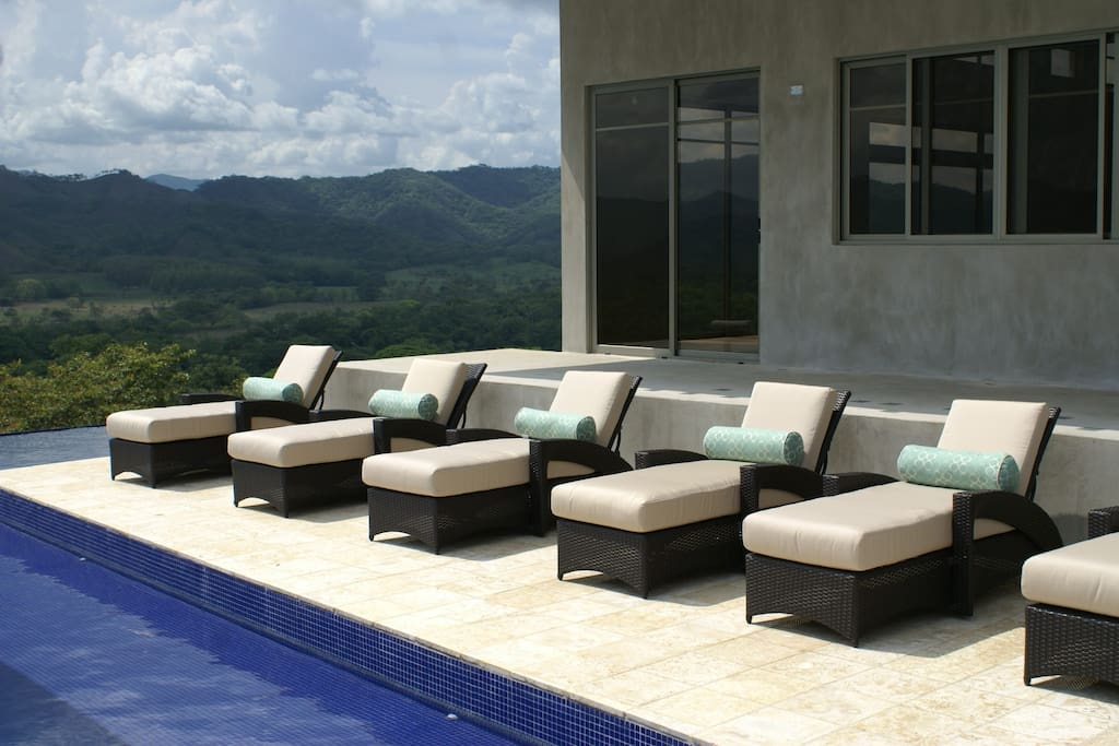 Chaise lounges for your comfort, and the pool has a shallow ledge covered in water for sunbathing.