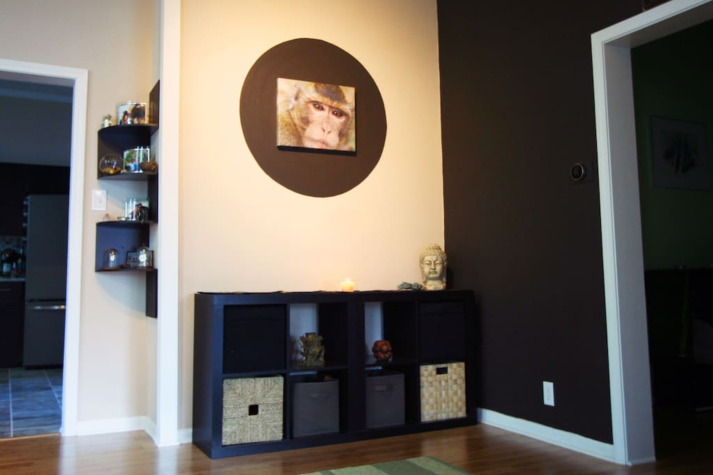 The entry foyer features some of Kelly's photography from travels. A warm and spacious entry foyer welcomes you into the kitchen.