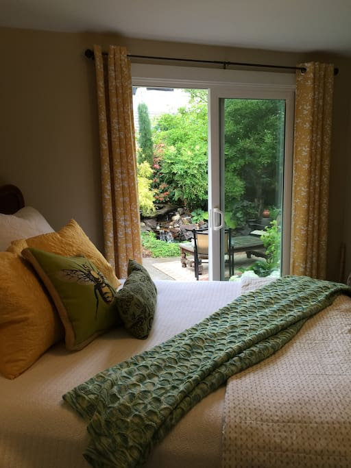 Guest room has opens onto private patio with Koi pond