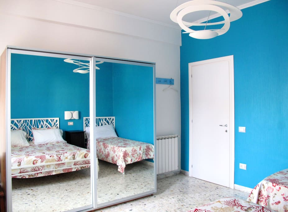 The Blue bedroom: Mirrored wardrobe.